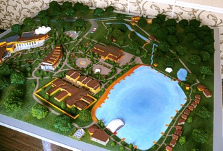 A model of a pond with fishing lodges