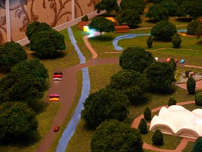 The road surface on the scale model is made in the style of wet asphalt