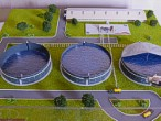 Maquette of sewage treatment pig farm plant to exhibition