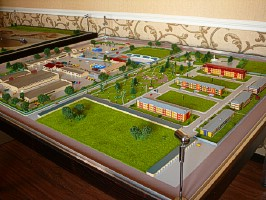 A scale model of a residential district with an adjoining industrial base